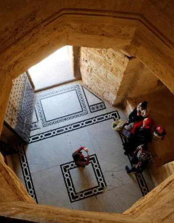 A family takes a picture inside the historic Citadel of Qaitbay, or Fort of Qaitbay, on the coastline in the Mediterranean city Alexandria